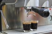 Prepares espresso in his coffee shop ,close-up — Stock Photo