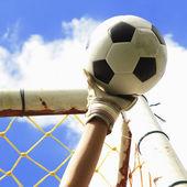 Soccer goalkeeper's hands reaching for the ball — Stockfoto