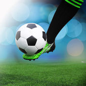 Football or soccer ball at the kickoff of a game - outdoors — Stock Photo