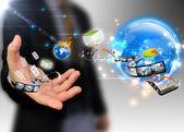 Businessman holding ideas around the world social media — Stock Photo