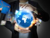 持有商业世界的商人 — 图库照片
