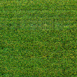 Stock Photo: Green sports field with artificial grass