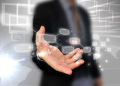 Businessman holding touchscreen — Stock Photo