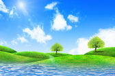 Green grass and river with bright blue sky — Stock Photo