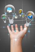 Businessman holding bulb idea design — Stock Photo