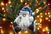 Christmas toy Santa Claus on skis. — Stock Photo