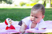 Cute little baby girl playing on the meadow — Stock Photo