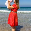 Mother and cute little baby girl on the beach — Stok fotoğraf