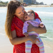 Mother and cute little baby girl on the beach — 图库照片