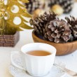 Composition with cup of tea, bumps and christmas tree — Foto Stock #35542885