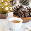 Composition with cup of tea, bumps and christmas tree — Foto Stock #35542899