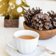 Composition with cup of tea, bumps and christmas tree — Stock Photo