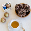 Christmas composition with cup of tea, balls and bumps — Foto Stock #35542971