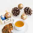 Christmas composition with cup of tea, cookies and bumps — Foto Stock #35543071