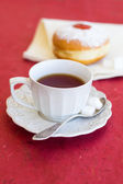 A cup of tea with fresh donut — Stock Photo