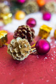 Christmas composition with garland, balls and bumps — Foto Stock