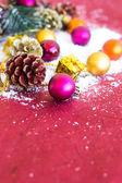 Christmas composition with garland, balls and bumps — Stockfoto