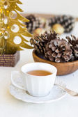 Composition with cup of tea, bumps and christmas tree — Foto de Stock