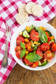 Tomato salad with cucumber and croutons — Stock Photo
