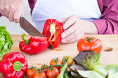 Man cutting vegetables for healthy salad — Stock Photo