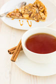 Cup of tea with delicious fresh baked  apple pie on a wooden sur — ストック写真