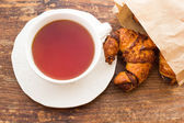 Cup of tea with croissant — Stock Photo