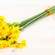 Bouqut of yellow lent lilyl (daffodil) on wooden table — Stock Photo #41670205