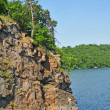 Bare rock and reservoir — Stock Photo