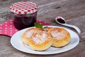 Homemade cheese pancakes on a plate — Stock Photo
