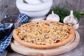 Pizza with cheese on a wooden board — Stock Photo
