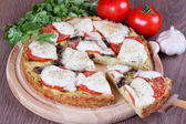 Slice of zucchini pizza and cheese on a wooden board — Stock Photo