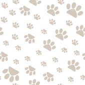 Seamless pattern with pet paws walking in different sides — Stock Vector