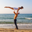Young couple practicing a dance scene at the beach. — Stock Photo #35742371