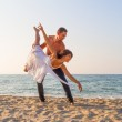 Young couple practicing a dance scene at the beach. — Stock Photo #35743745