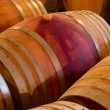 Oak wine barrels in a winery cellar — Stock Photo #35757957