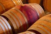 Oak wine barrels in a winery cellar — Stock Photo