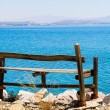 Sea view relaxation old wooden bench. — Stock Photo