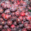 Delicious ripe juicy plums at local market — Stock Photo