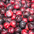 Delicious ripe juicy plums at local market — Stock Photo #35779681