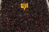 Wrinkled partially salted greek black olives. — Stock Photo