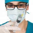 Male doctor (or nurse) holding a syringe — Stock Photo #44081781