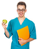 Doctor with an apple — Stock Photo