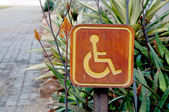Cripple sign wood label in garden — Stock Photo