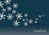 Abstract snowflakes background with a space for text — Stock Vector