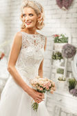 The beautiful  woman posing in a wedding dress — Stock Photo