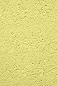 Background of yellow foam — Stock Photo
