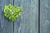 Heart on a gray background of the fence — Stock Photo