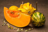 Pumpkin on fabric background — Stock Photo