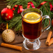 Mulled wine with anise and christmas ball — Stock Photo