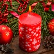 Red candle and Christmas balls — Stock Photo